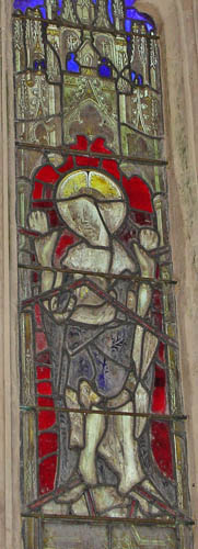 Enlarged portion of stained glass window in St. Michael's church at Cadbury